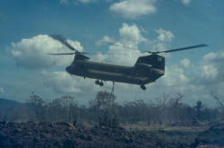 Chinook delivering large quantities of stores by underslung & internal means.  One Chinook delivered over 100 ARVN soldiers to FSPB PICTON for local training