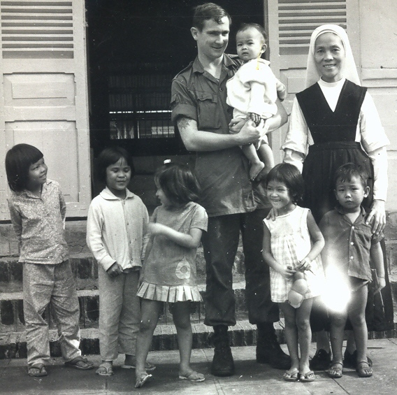 Cpl Baden Ewart with orphans & nun, Baria Orphanage 1970 or early 1971 [Young]