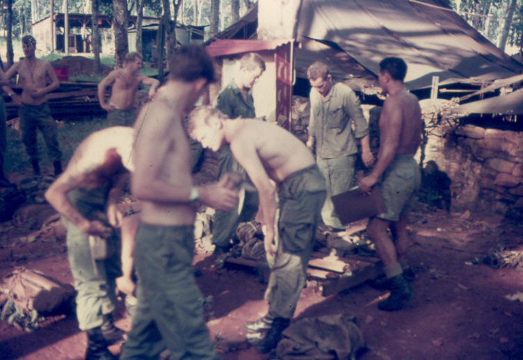 2Pl sorting equipment under Sgt Harry Hemana [wearing shorts on right] prior to returning to the field on 8 October 1970