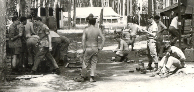 Pre-operation admin in 2Pl  lines at NUI DAT - Lt Upton on left in shorts